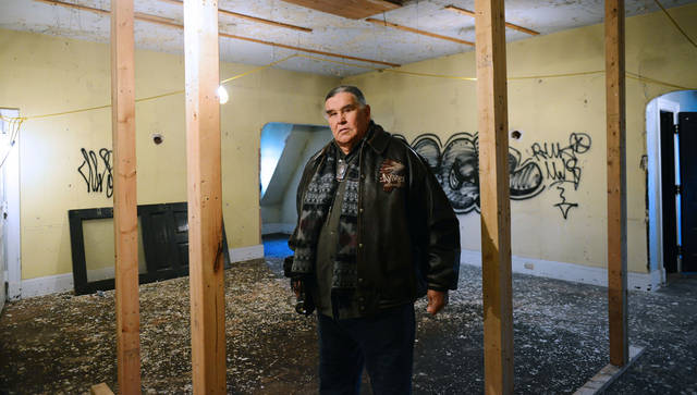 American Indian Movement Director and co-founder Clyde Bellecourt poses in the 6,444-square-foot Henry B. Frey Mansion on Tuesday. The organization is selling the mansion to raise funds to build a cultural center. (Photo by Holly Peterson)