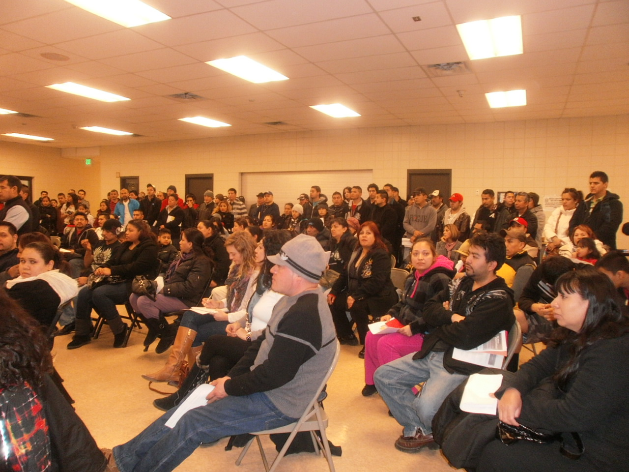 Crowd listens intently to immigration discussion at January 25 meeting at Waite House. (Photo courtesy of Rosa C.)
