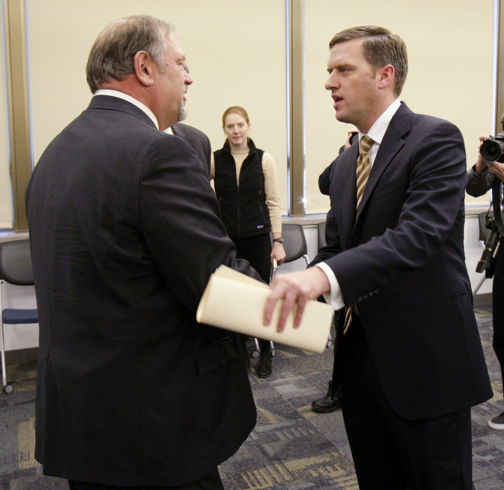 (Photo by Paul Battaglia) Senate Majority Leader Tom Bakk, left, and House Speaker-designate Kurt Daudt greet after they both made comments regarding the Dec. 4 release of the November Budget and Economic Forecast.