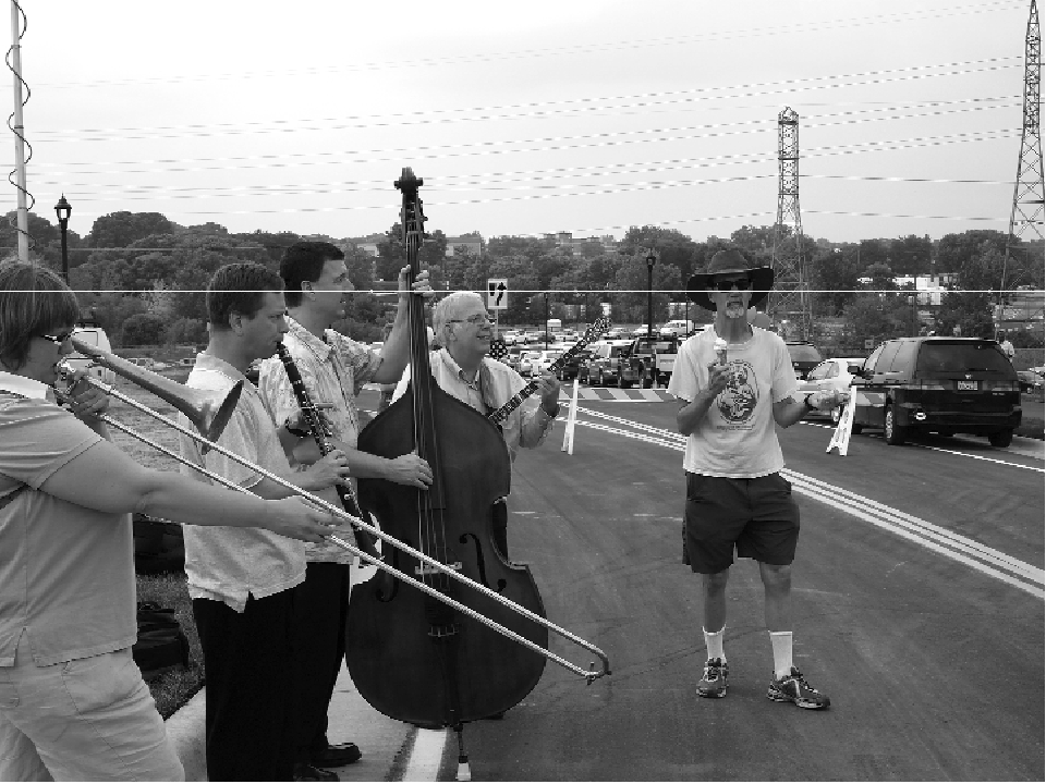 The Minnesota Dixie Dixieland Band performed last summer at the opening of the Van White Memorial Bridge. Left to right: Joy Judge, trombone; Steve Pikal, bass; Fred Richardson, clarinet; and bandleader Kerry Ashmore, banjo. (Photo by Margo Ashmore)