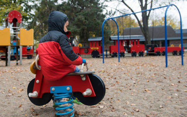 (Photo by Cora Nelson) A child sits on a toy bike at Van Cleve Park on Oct. 30, 2014. The park board superintendent's proposed budget allocates about $300,000 to the park in 2020 to help improve its facilities.