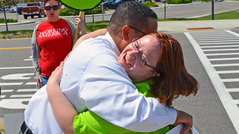 U.S. Rep Keith Ellison hugs Cantare Davunt, who walked out of her job at Walmart in Apple Valley to join the OUR Walmart strike. (Photo by Michael Moore)