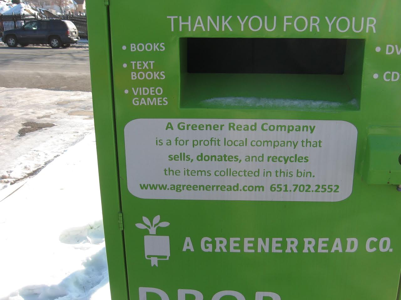 (Photo credit: Forum staff) These green bins, soliciting donations of books and video games, look similar to bins set out by nonprofit organizations seeking donations for people in need.