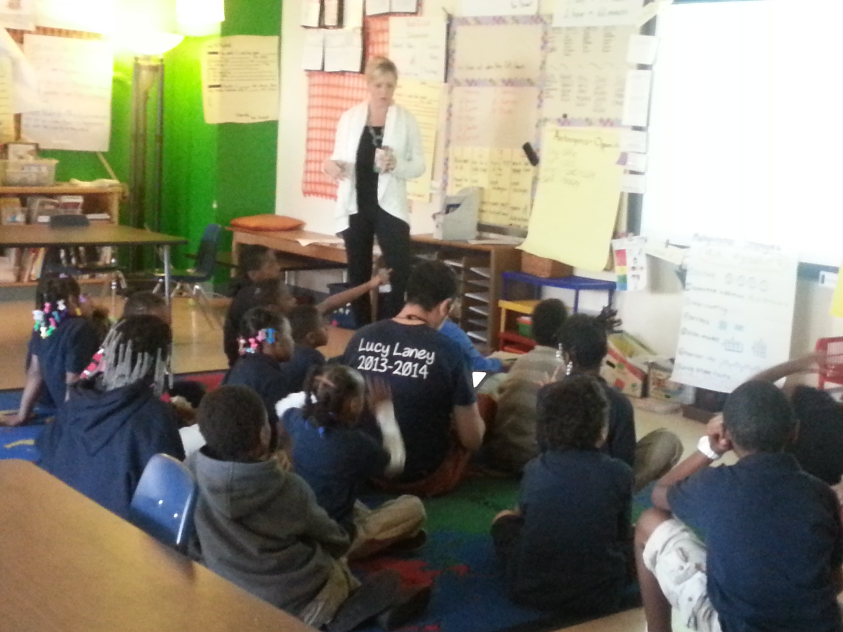 The classroom teacher, sitting on the floor, is Scott Teigland and the co-teacher is Sarah Stark (standing.) (Photo by Sarah Lahm)