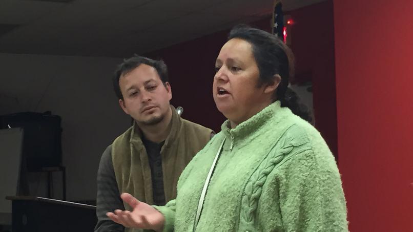 Colombian organizers Josefa Gomez and Leonardo Luna Alzate speaking in Minneapolis