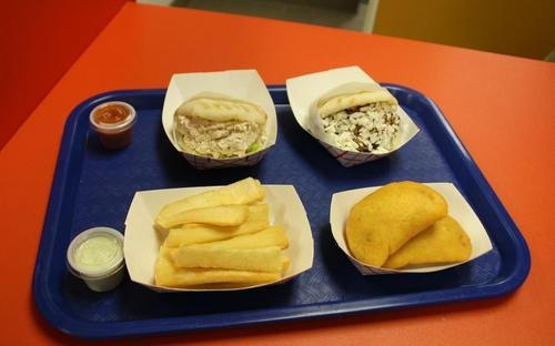 lunch_for_two_shredded_chicken_and_black_been_and_cheese_arepas_withfried_yucca_and_an_order_of_empanadas