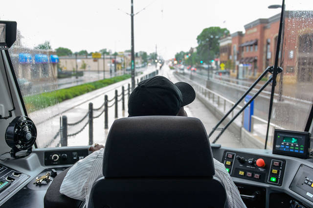 Rail operator Rolland Green drives a test train on Light Rail Transit's Green Line on Saturday. There will be a grand opening for the Green Line on Saturday. (Photo by Samuel Harper)