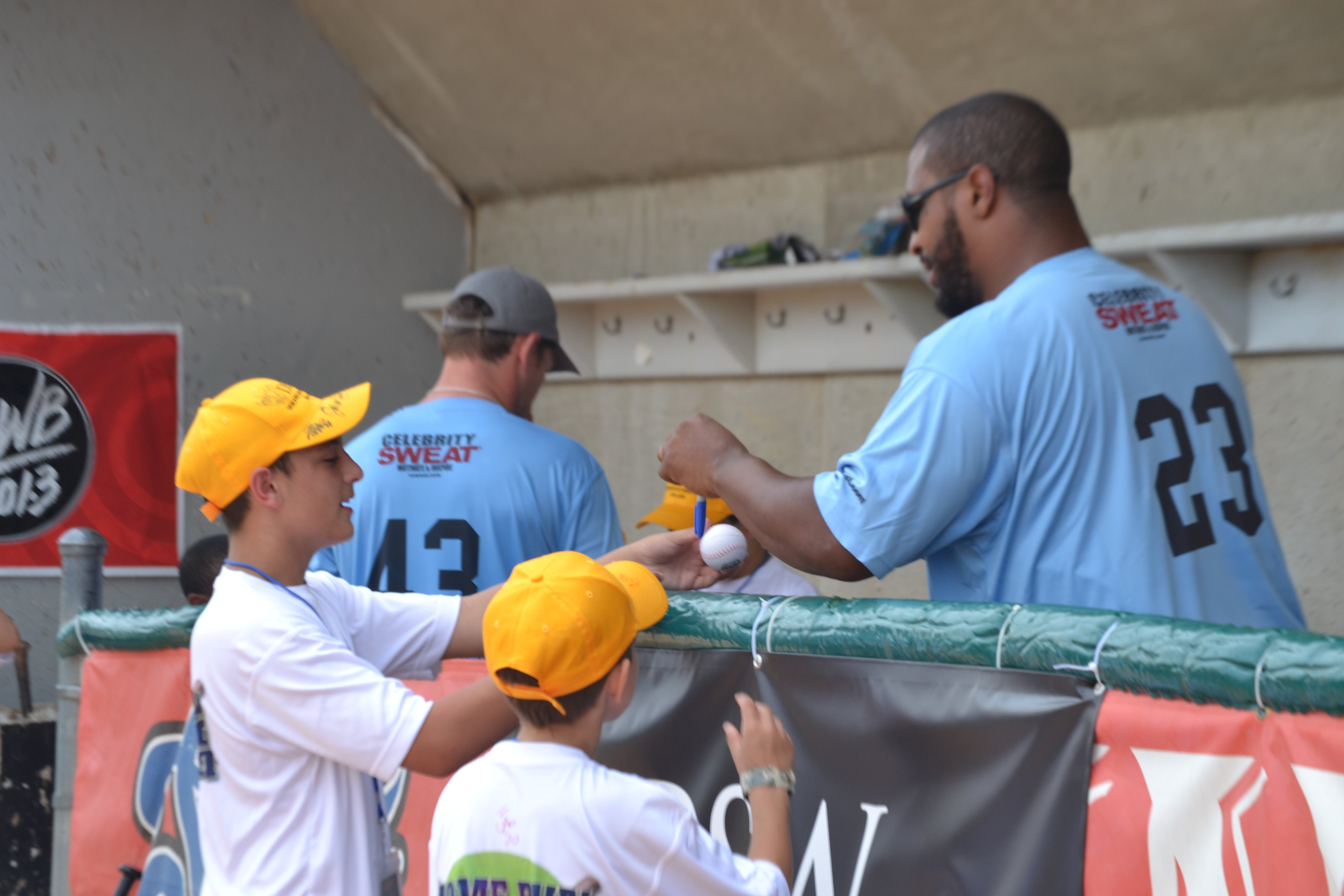 Anthony Gresafe (left) gets autograph from Daunte Culpepper  (no. 23, right).
