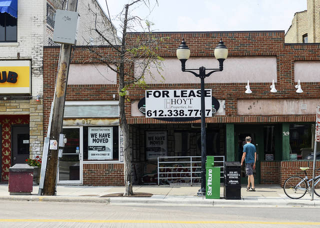 A man looks at the building where Bruegger's Bagels was located on 14th Avenue in Dinkytown on July 10, 2014. The shop closed in June because of an increase in the retail space's rent rate. (Photo by Holly Peterson)