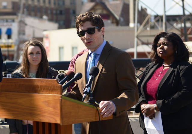 City Council member Jacob Frey speaks to the press Friday in Dinkytown about being safe after Saturday's Gophers men's hockey team's NCAA championship game. (Photo by Bridget Bennet)