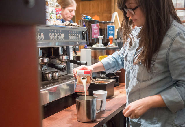 (Photo by Zachary Bielinski) Barista Allison Noble makes a drink with soy milk Monday, Nov. 10 at Bordertown Coffee. Local businesses say they are trying to avoid increasing their prices while the cost of milk rises.
