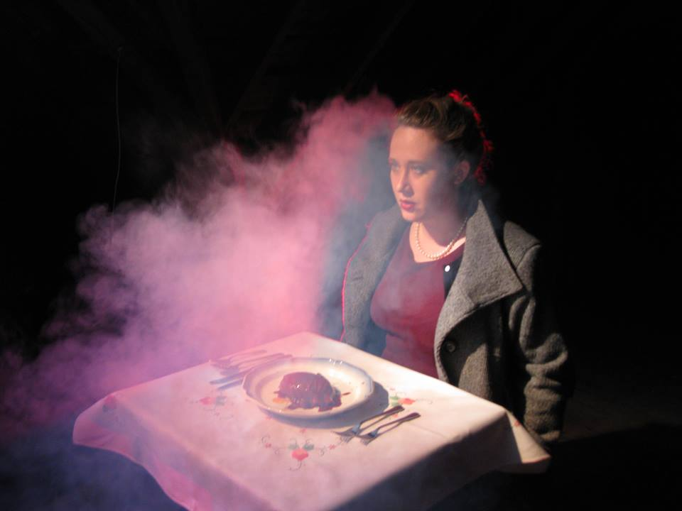 Alice (Blake E. Bolan) sits down for a heart-y meal in Body House - photo courtesy of Gwethalyn Williams and Megan Clark