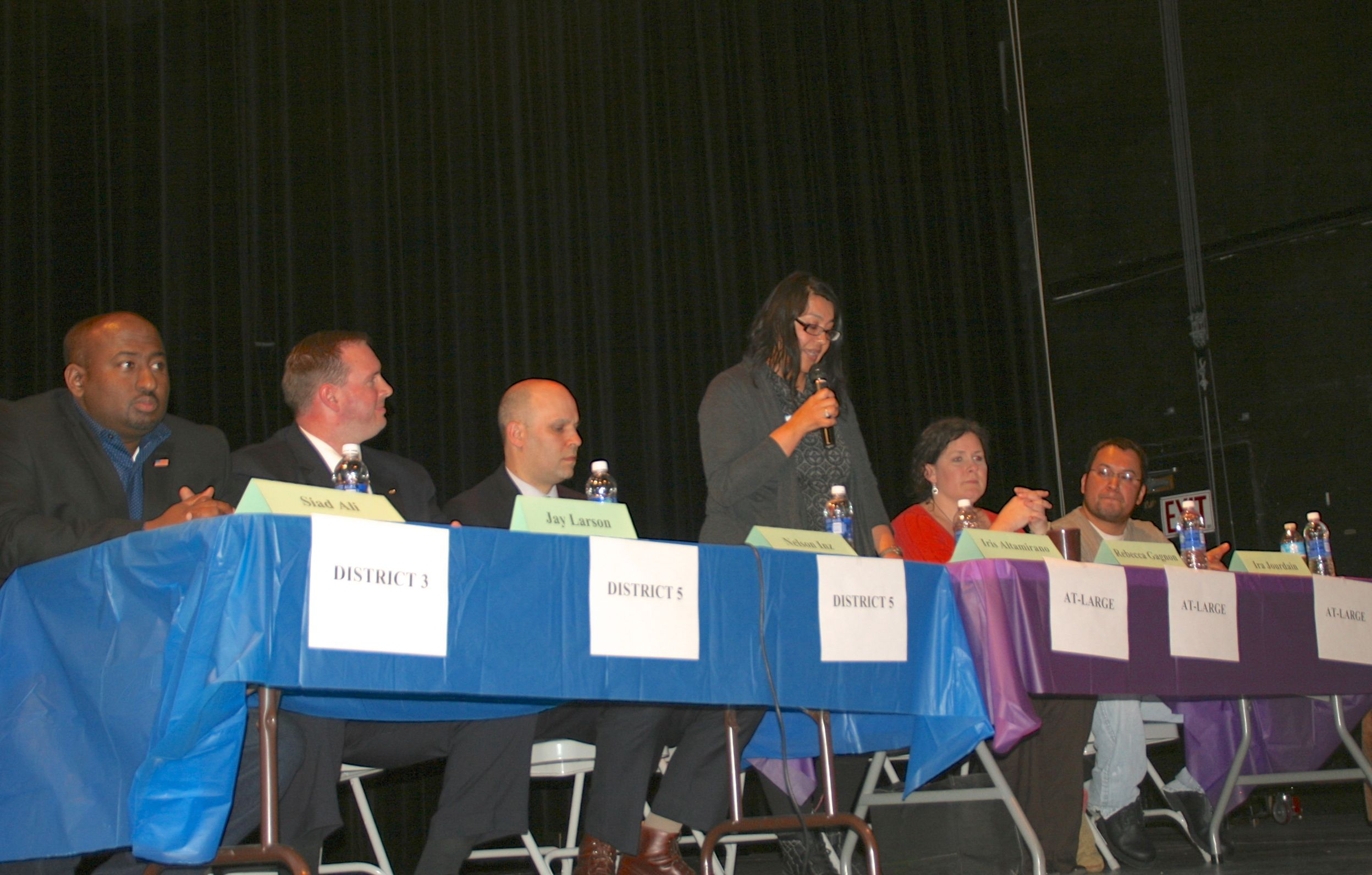 Candidates address the audience about how they would solve problems in public education in Minneapolis.