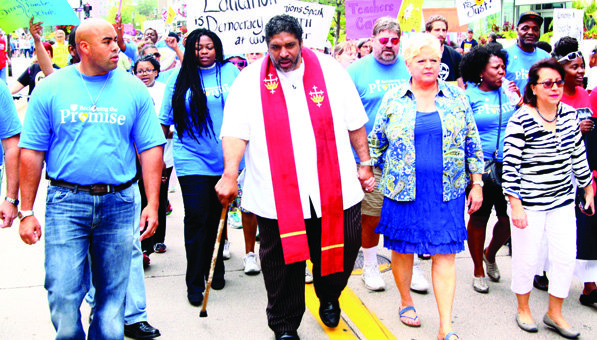 "Rev. Dr. William Barber (center) led a ""March for Equity"" in downtown Minneapolis on Saturday, August 16."