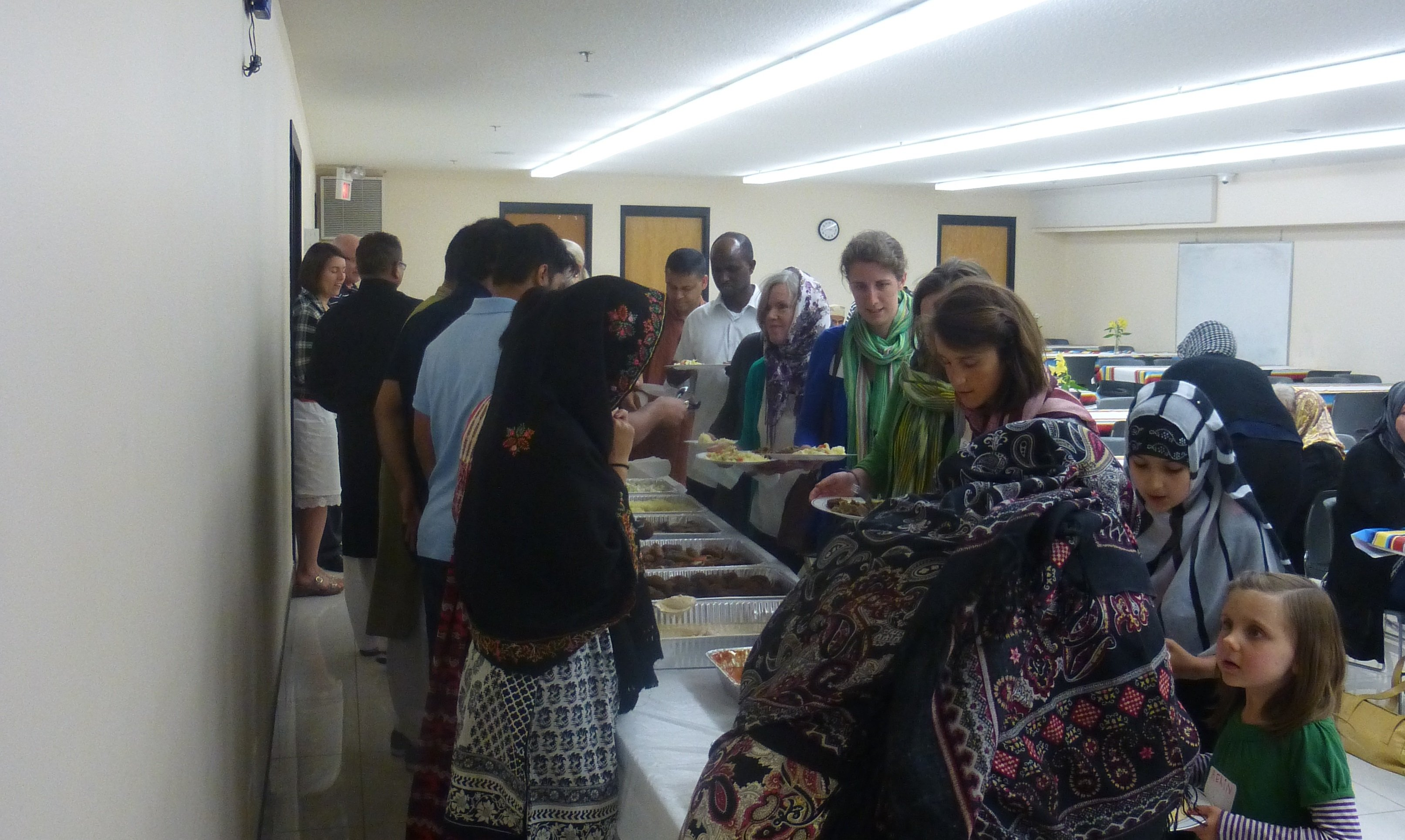 (Photo by Ellen Squires) Participants line up to eat from the Iftar buffet at the end of the program.