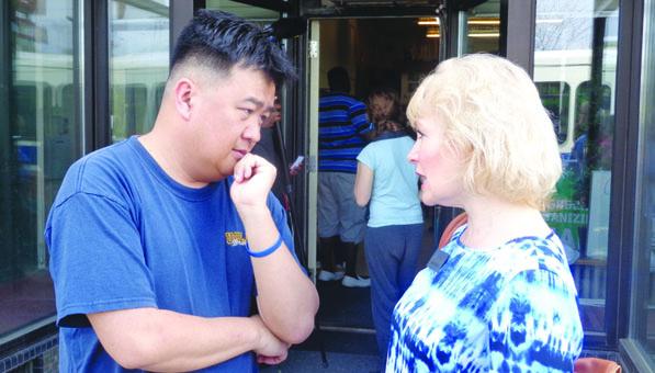 Minneapolis City Council Member Blong Yang and Met Council member Jennifer Munt (Photos by Charles Hallman)