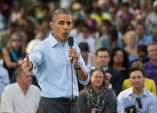 President Barack Obama addresses a crowd during a town hall meeting held at Minnehaha Park on Thursday afternoon. (Photo by Bridget Bennett)