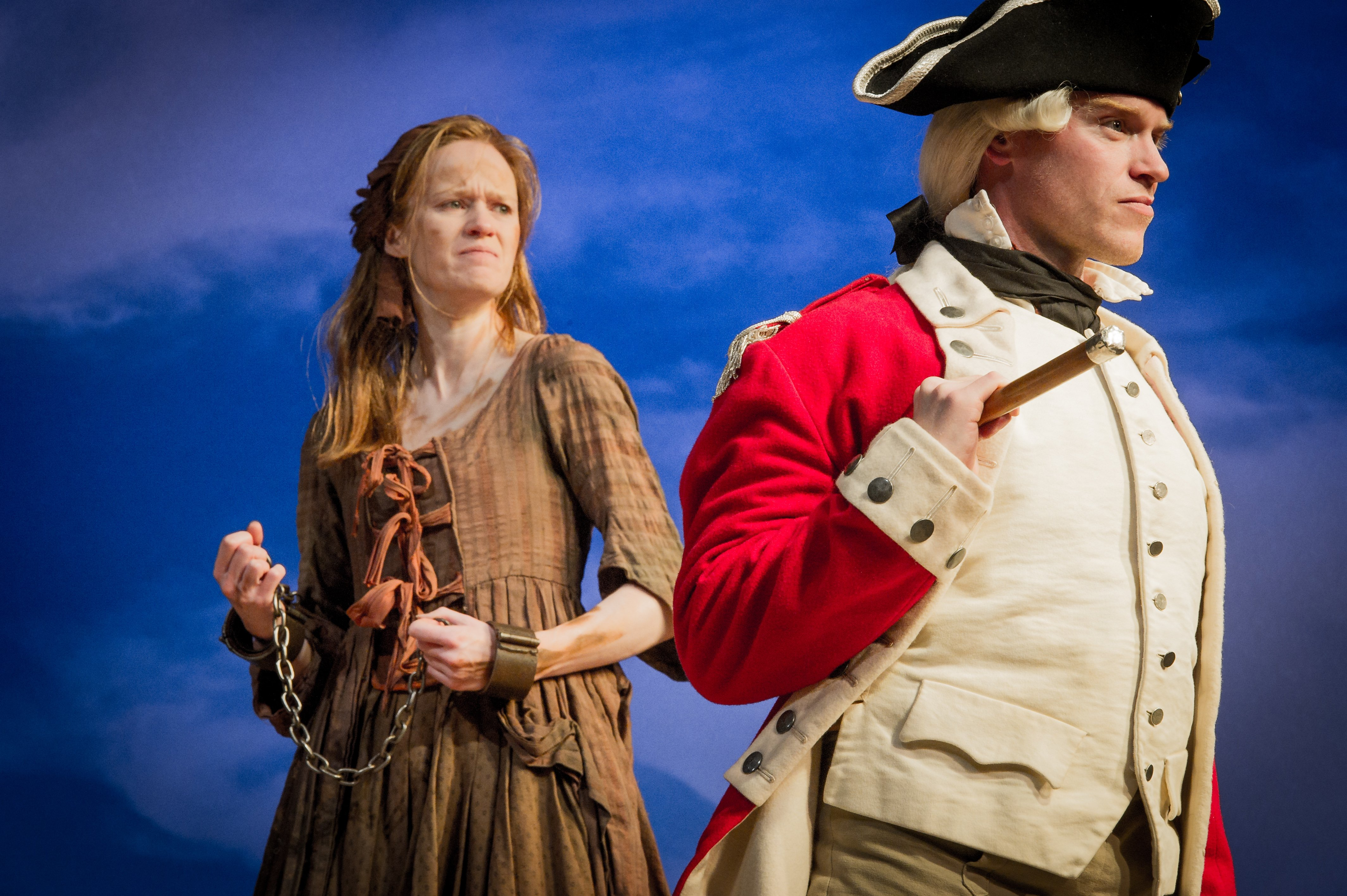 Major Ross (Richard Neale) interferes with convict Liz Morden (Kathryn O'Reilly)'s rehearsal process in Our Country's Good. Photo by Robert Workman.