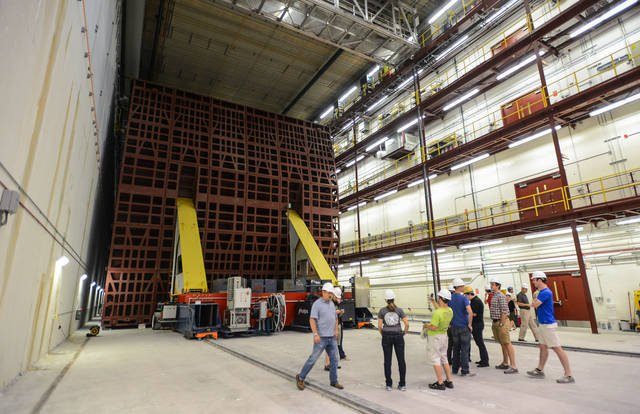 (Photo by Bridget Bennett) Members of a tour group take photos while observing the NOvA far detector on July 24, 2014, in Ash River, Minn. The 14,000-ton detector is one of the world's largest free-standing plastic structures.