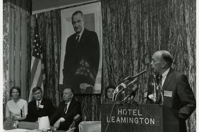 Minnesota governor Karl Rolvaag addresses the 1966 DFL state convention, with a poster of President Lyndon Johnson prominently displayed in the background. (Courtesy of the Minnesota Historical Society/Jerome Liebling)