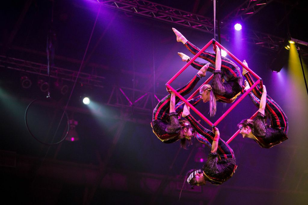 Members of Circus Juventas model the spinning cube. Photo by Dan Norman.