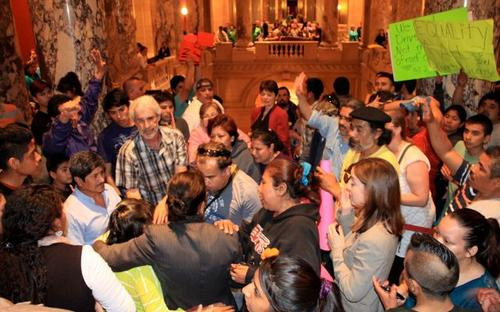 Supporters of SF271, which would give undocumented immigrants the ability to get drivers' licenses, gather outside the MN Senate chamber after it passed in 2013.