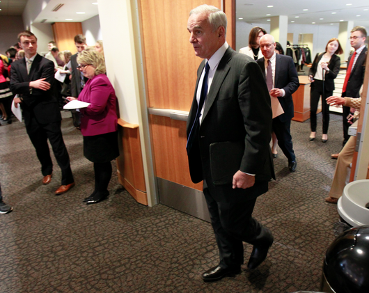 Gov. Mark Dayton enters the room to deliver his biennial budget proposal Jan. 27. Photo by Paul Battaglia