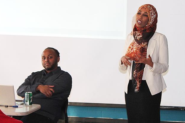 Amran Farah, right, offers advice about individual rights and police interactions. MinnPost photo by Ibrahim Hirsi