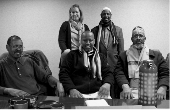 Front row (left to right): Nur Ahmed, Sh. Abdirahman Omar, and Sh. Ahmed Burale. Behind them are Attorney Nikki Carlson and Sh. Abdirashid Tuure. Sh. stands for Sheik, a term for Muslim leaders and clerics. (Matt Grimley)