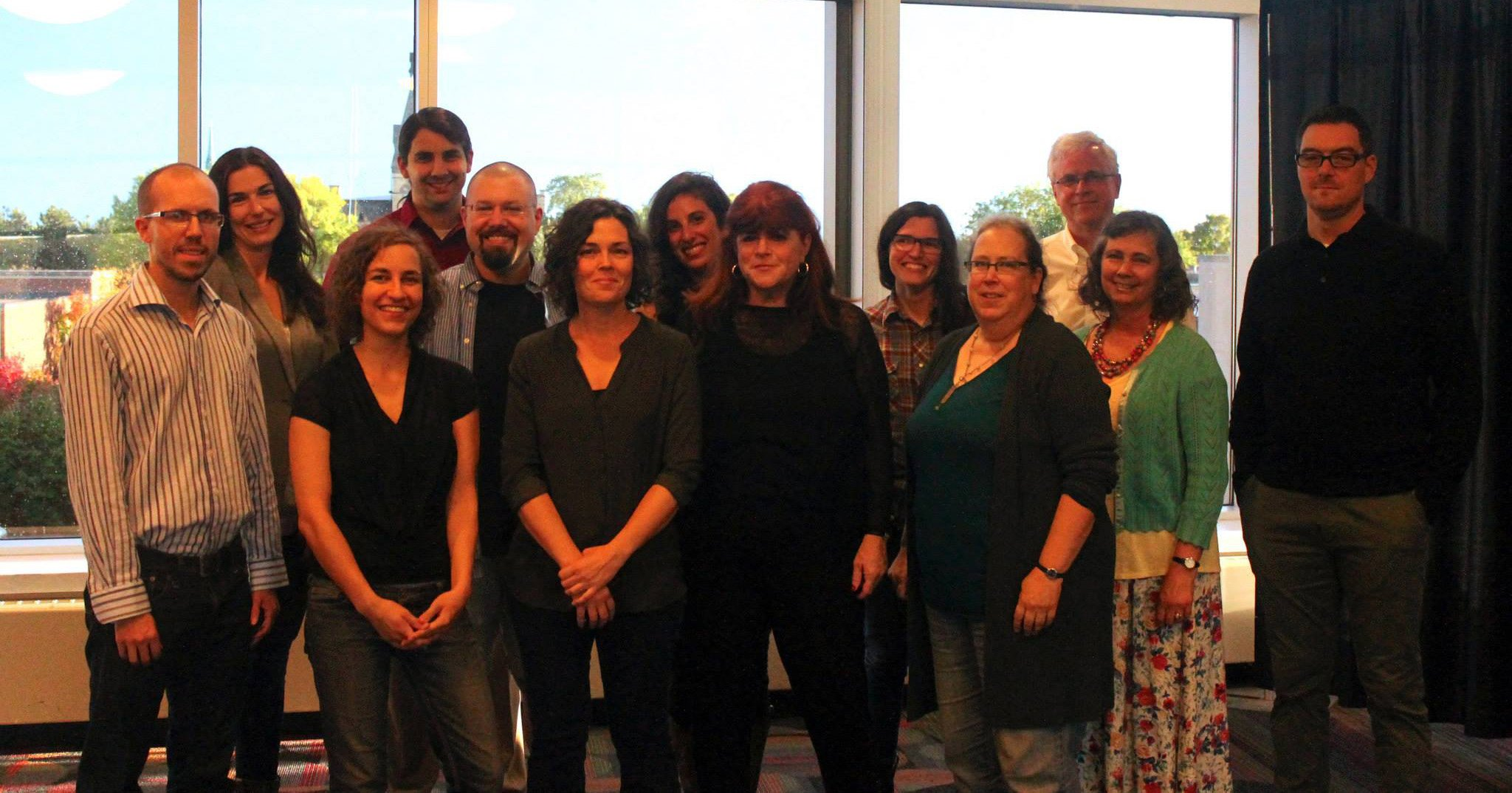 Pictured from left to right are volunteers with the Minnesota Prison Writing Workshop at a reading at Hamline University on September 20, 2014: Dain Ingebretson, Kathryn Savage, Anika Eide, Peter Pearson, Nico Taranovsky, Jennifer Bowen Hicks, Elizabeth Tannen, Deborah Appleman, Mary Stein, Nell Ubbelohde, Scott Carpenter, Wendy Brown-Baez, and Bill Breen. Photo by Henry Breen.