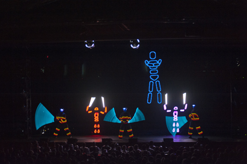 Blue Man Group in lighted suits