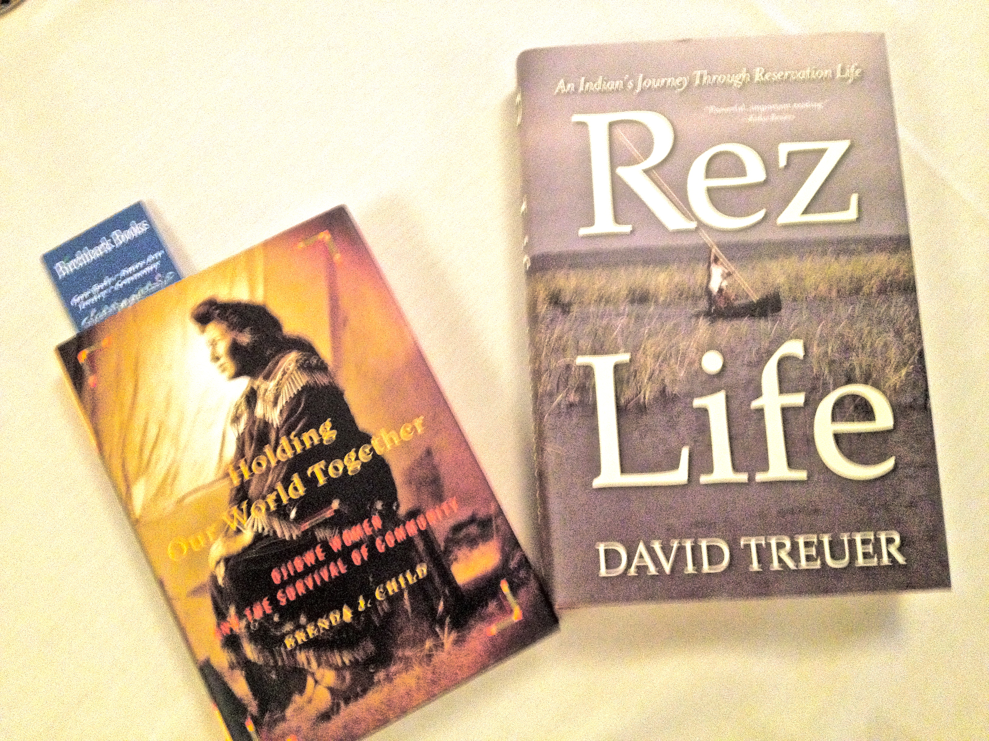 Recent books by Native American authors Brenda Child and David Treuer.