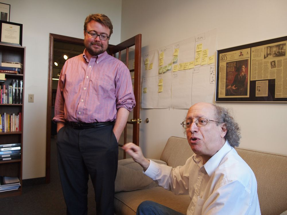"Chris Fischbach and Allan Kornblum reflect on the growth of Coffee House Press. In the photo on the wall is Norah Labiner, author of the first book Fischbach worked with as editor. His favorite read? ""I've always had a soft spot for The Great Gatsby."""