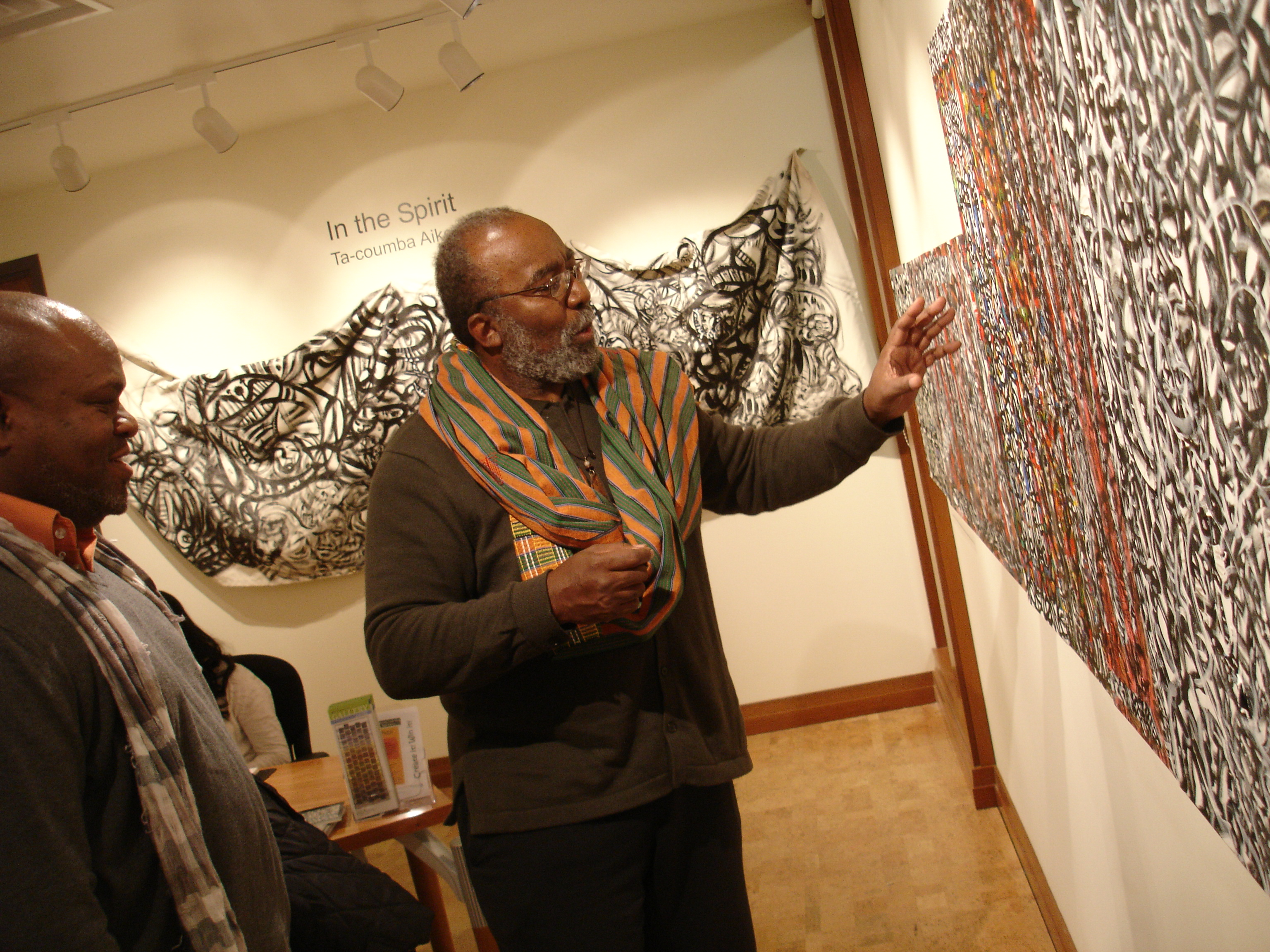 Ta-coumba Aiken talks about his work. Photo by David Jarnstrom.