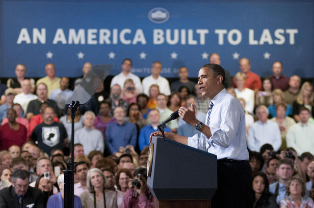"President Barack Obama addresses the crowd Friday at Honeywell International in Golden Valley, Minn. about the economy and discussed issues surrounding returning veterans and employment. ""Honeywell has hired 900 veterans over the past year,"" Obama said. ""Standing up for our veterans, this is not a Democratic responsibility, it's not a Republican responsibility, it's an American responsibility."" (Photo by Marisa Wojcik)"