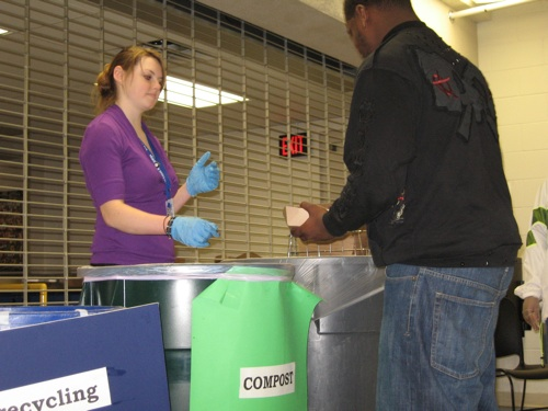 Americorps Volunteer Whitney Hough coaches an Edison High School student on composting (Photo courtesy of Edison High School)
