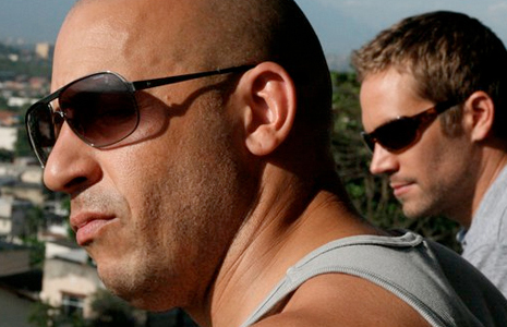 Vin Diesel (left) and Paul Walker in Fast Five. Image courtesy Universal Pictures.