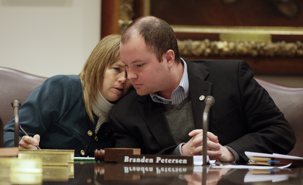 "Rep. Branden Petersen and Sen. Pam Wolf confer during the March 26 conference committee on the so called ""Last-In, First-Out"" education bill. (Photo by Paul Battaglia)"