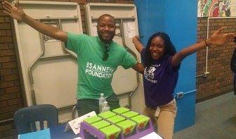 Timothy Sayon of the Sanneh/Conway Recreation Program and eighth grade student Michaela Kamara.