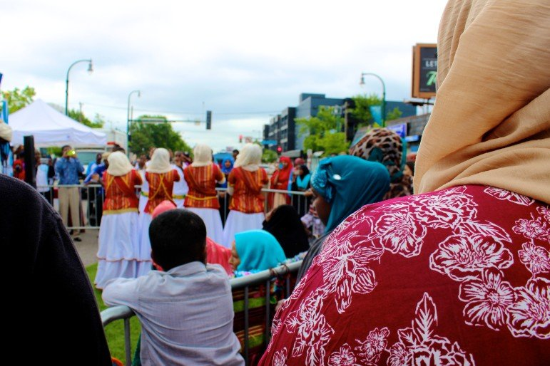 Crowds formed to watch and record the dances.