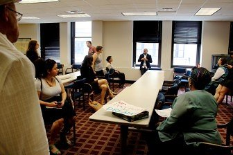 After the meeting, Phillips residents started planning their next steps. Photo by Kayla Steinberg
