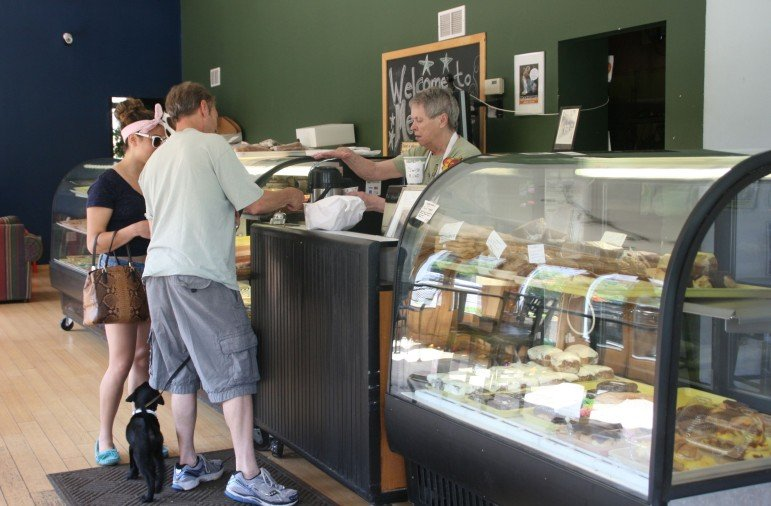 A steady stream of customers come to the shop for their favorites.