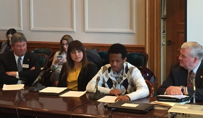 Chala Tafesa, a high school student at Community of Peace Academy in St. Paul, testifies at the State Capitol.