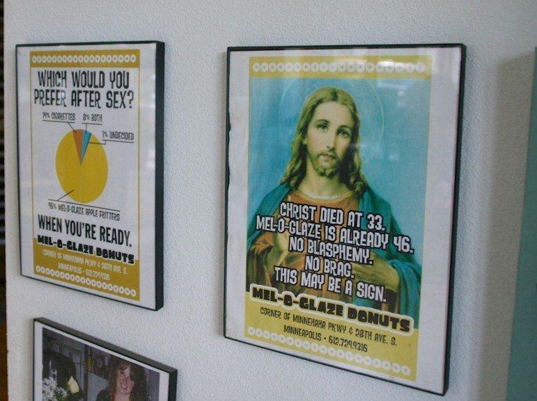 Framed advertising posters.
