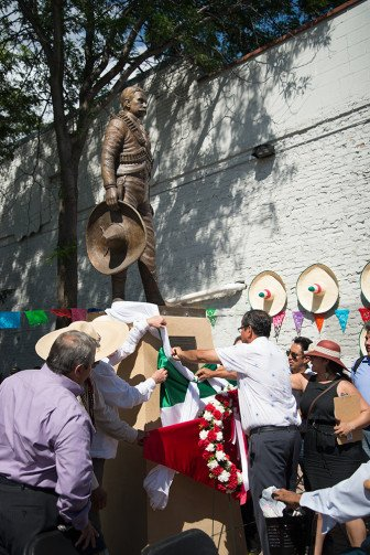 The plaque on the statue of Emeliano Zapata is unveiled