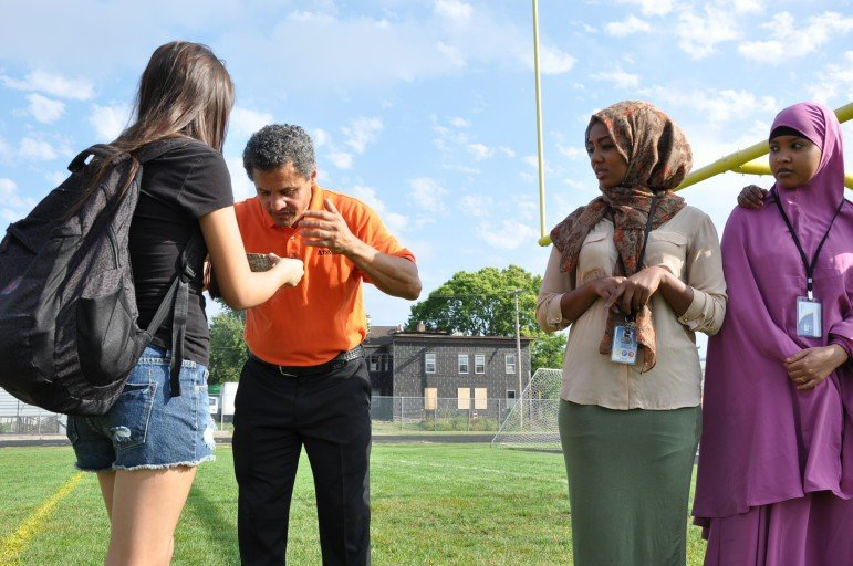 Principal Aponte  demonstrates to some new students. Photo courtesy of Minneapolis Public Schools
