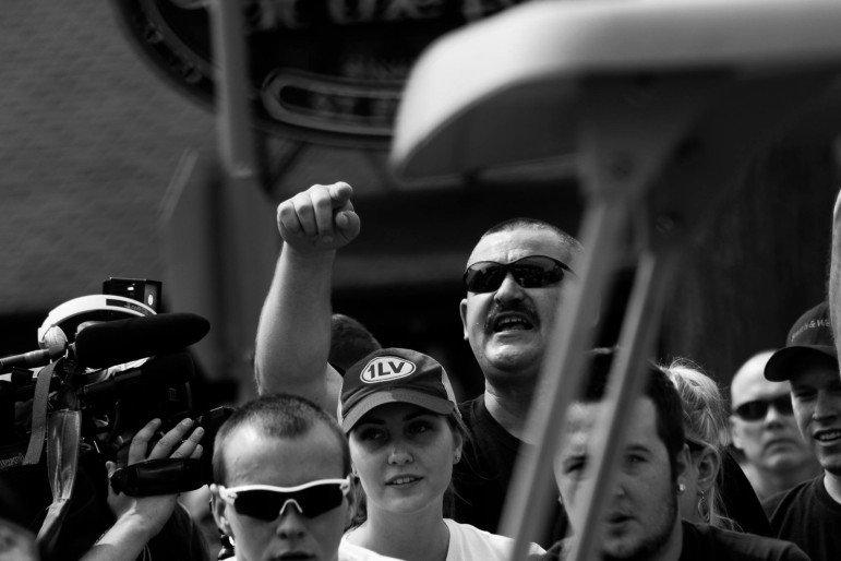 White fairgoers jeer at Black Lives Matters protestors.