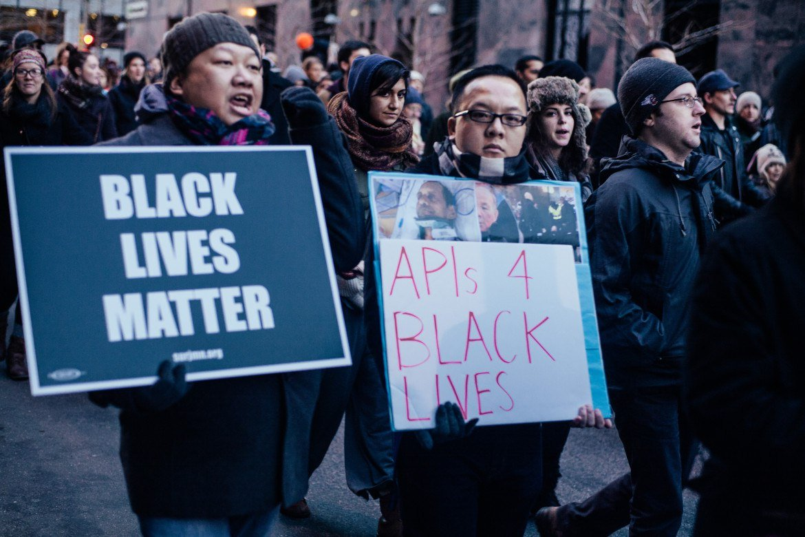 Asian American protesters support Black Lives Matter in a Nov. 24 march in Minneapolis.