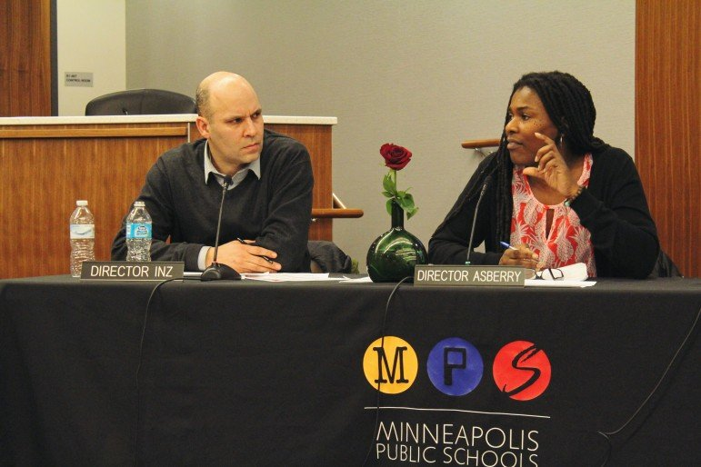 Director Tracine Asberry (right) describes ways she believes the school district could improve community engagement with the superintendent search at the Board of Education's Jan. 26 committee meeting