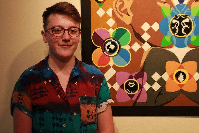 Aza Erdrich in front of her artwork. Photo by Nikki Rykhus.